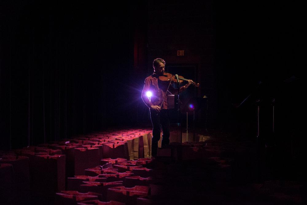 Elliot Vaughan performing in Sugar's Waste.
