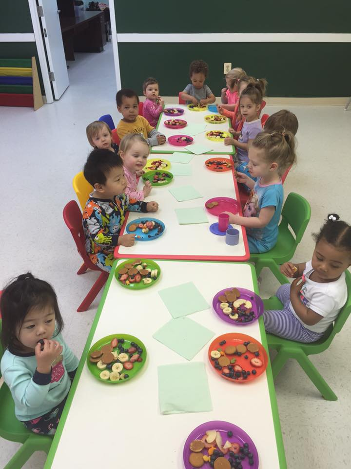 Our Rising Stars enjoying snacks on Pajama day.