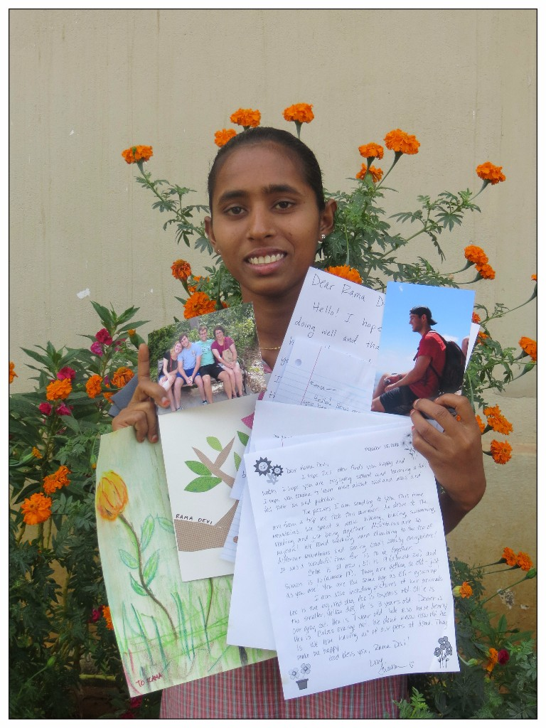 "This is Devi and she's holding some of the letters and artwork she's received from her sponsors. ""This is only the tip of the iceberg of what Devi has stashed away like a valuable treasure. She keeps all she receives and cherishes every piece of correspondence she gets from her sponsors."" says Sue, our One Life advocate to India."