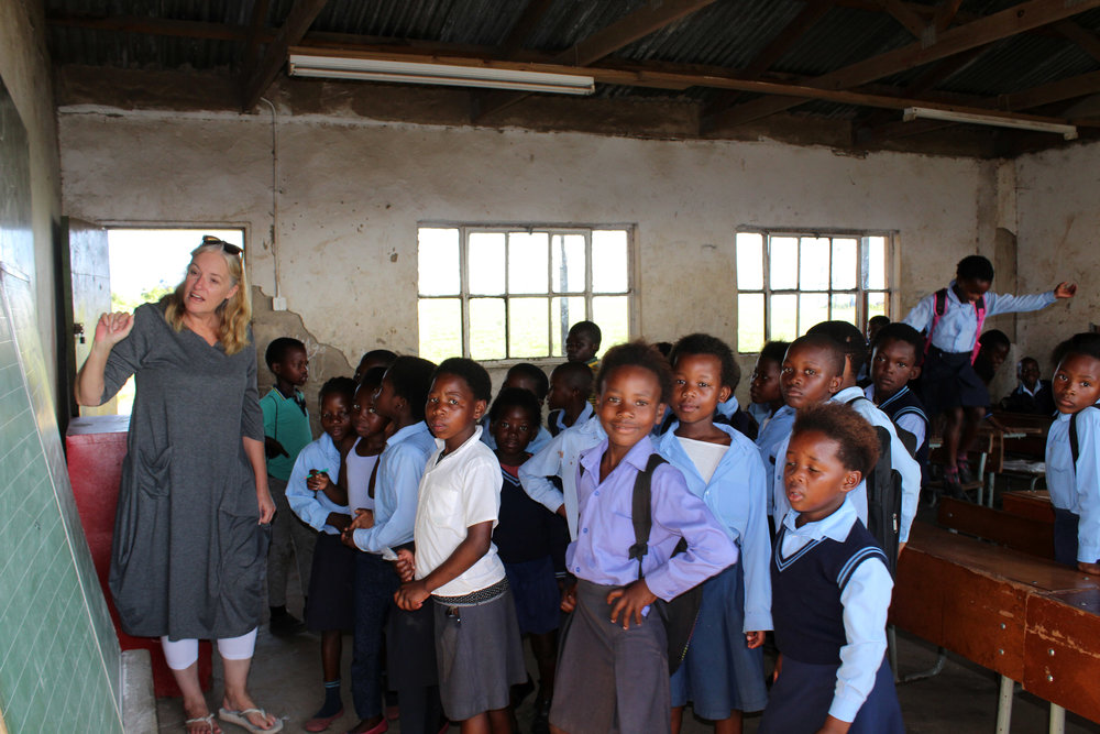 Alison, One Life South Africa Director, teaching a class of kids who don't have a teacher but come to school every day and sit hoping one shows up.