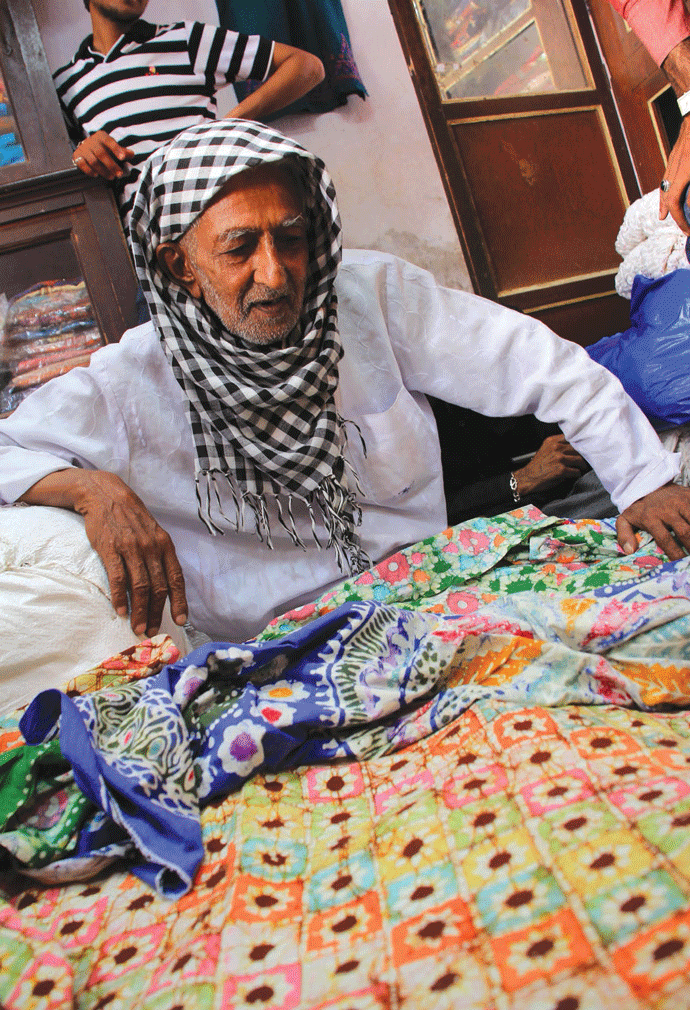 Khatri Suleman with his batik print from the '80s
