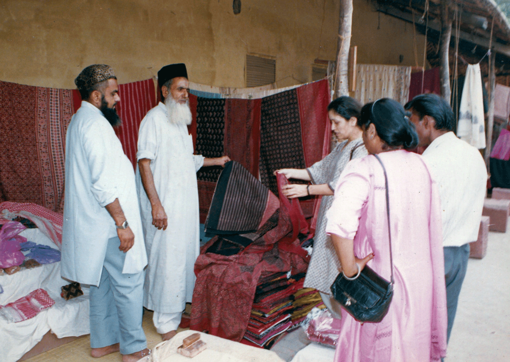 Mohammed Siddique Khatri and his son, Razzaque Khatri, speak to visitors at an exhibition in Delhi