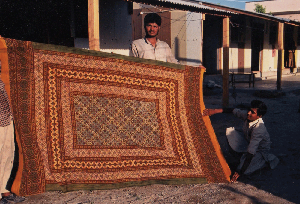A bedsheet dyed with natural colors from Dhamadka