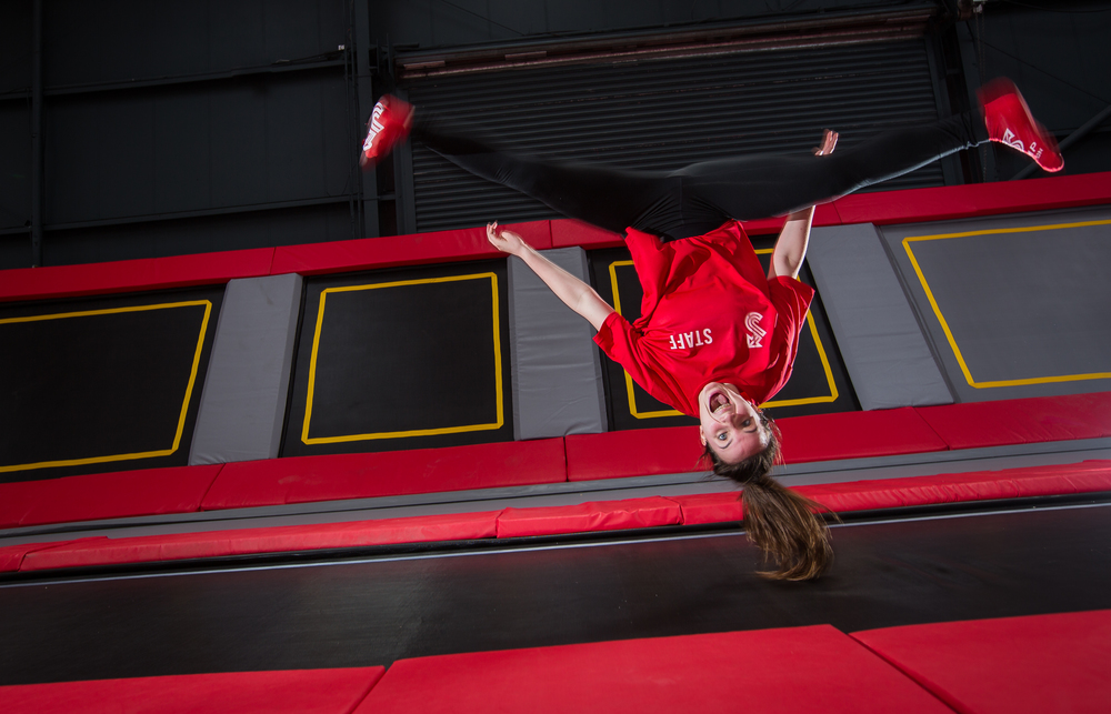 one of the team from team Kinetix parkour setting the standard at Jump Evolution Indoor trampoline park in Romford Essex
