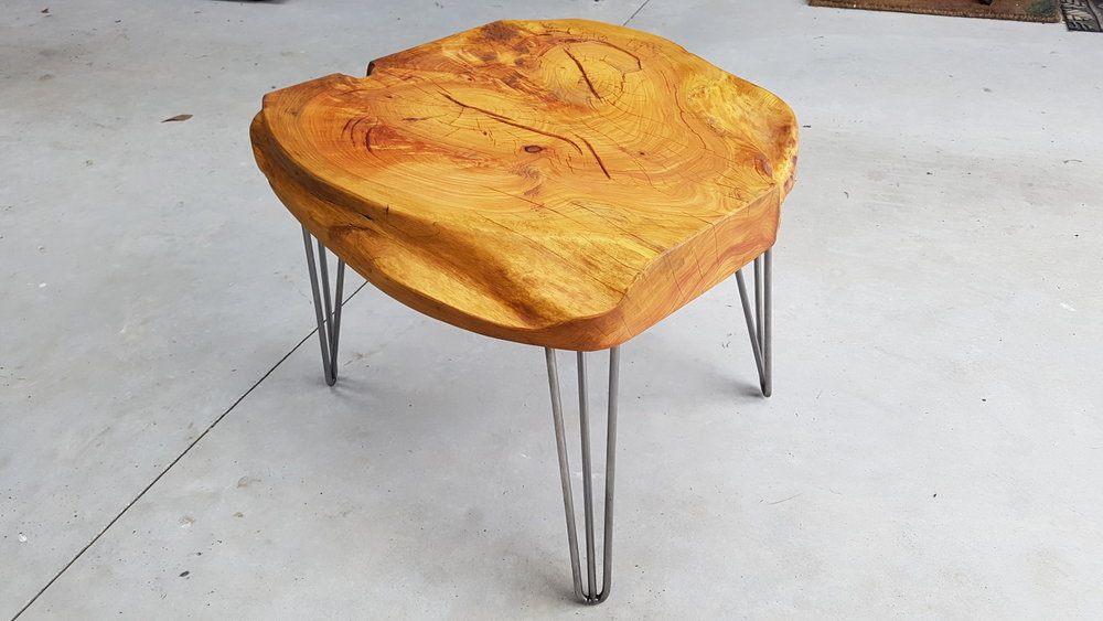 600 x 600mm Macrocarpa on three pin legs, sold for $480