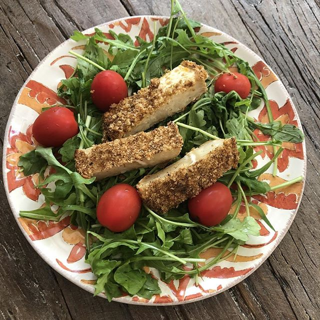 Fresh Arugula with cherry tomatoes and breaded celeriac root salad. The celeriac root and arugula came fresh from the organic farm at #amblerfarmersmarket. The shake and bake celeriac root recipe is from the latest @vegnews magazine. It's delicious and #vegan.