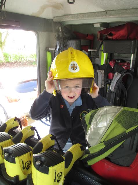 in firemans helmet.jpeg