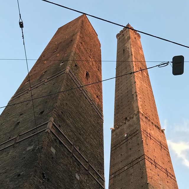 It's all a matter of perspective, one tower is actually 3 times taller than the other, but find the right angle... #Perspective #TheTowers #Bolgna #Italy #bluesky