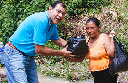 Founder Miguel helping one of the villagers in Teupasenti.