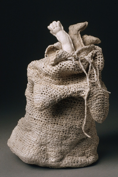 Karen Searle,  Body Bag I: Terms of Endearment , 1999, crocheted handspun flax, abaca lining, cast paper forms, wire, tags, 18 in. x 10 in. x 8 in.