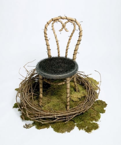 Jill Waterhouse,  Out of the Earth Like Iron II , 2004, French cafe, chair, blue-steel carpet tacks, vintage barbed wire, grapevines, forest moss, approximately 40 in. x 42 in. x 41 in.