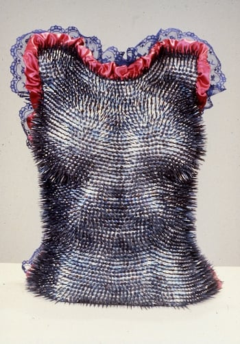Jill Waterhouse,  Out of the Earth Like Iron,  1988, Cast plaster female torso, 7/8 in. blued steel carpet tacks, blue lace edging, folded and tufted blood-red satin lining, 21 in. x 16 in. x 8.5 in. (detail)