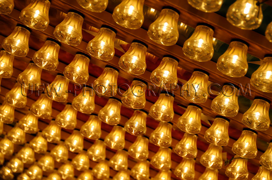 Diagonal pattern rows golden glowing small light bulbs Stock Ima