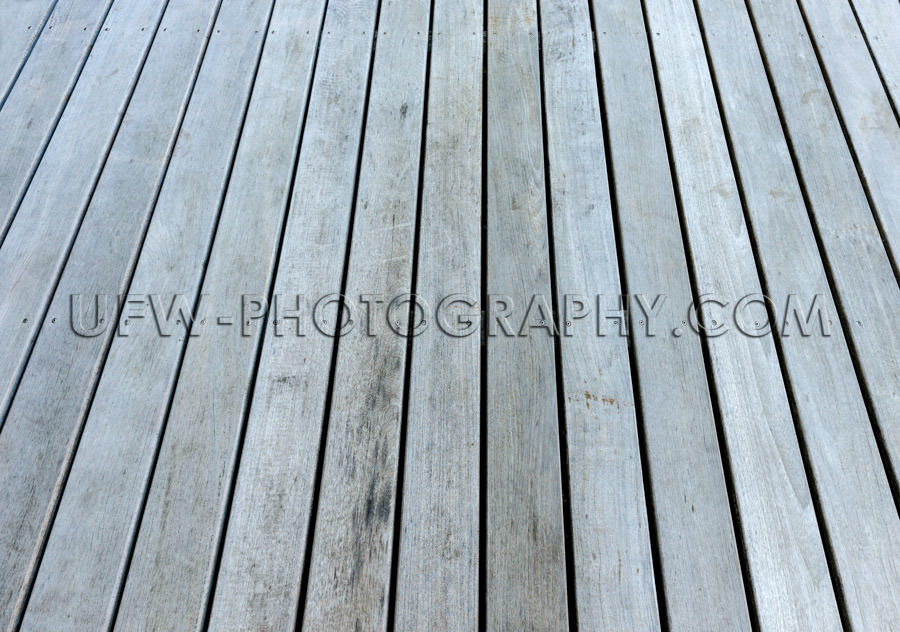 Gray weathered wood patio floor full frame plank background XXL