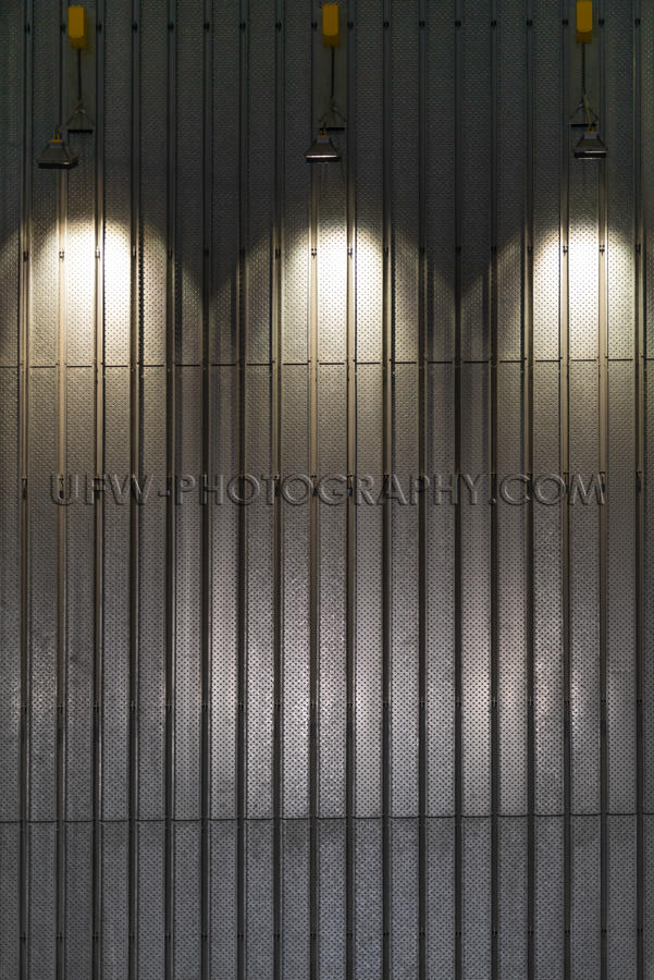 Metal wall illuminated spotlights abstract modern interior Stock