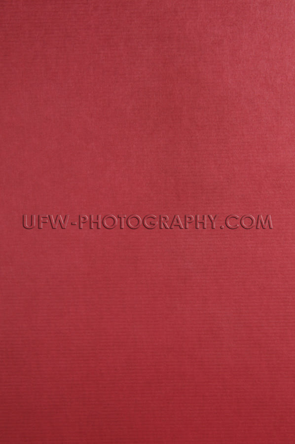 Red linen book cover evenly textured elegant ruby background Sto