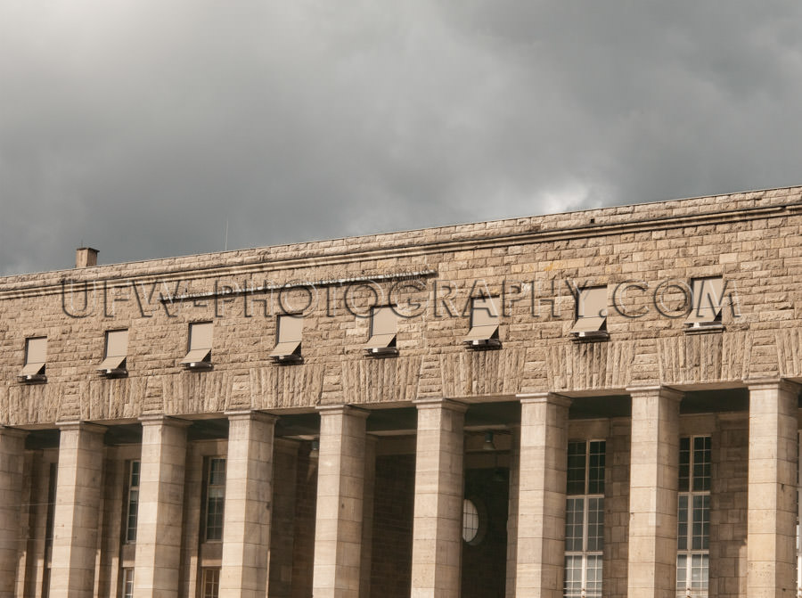 Classic limestone building under gray clouds Stuttgart railroad-