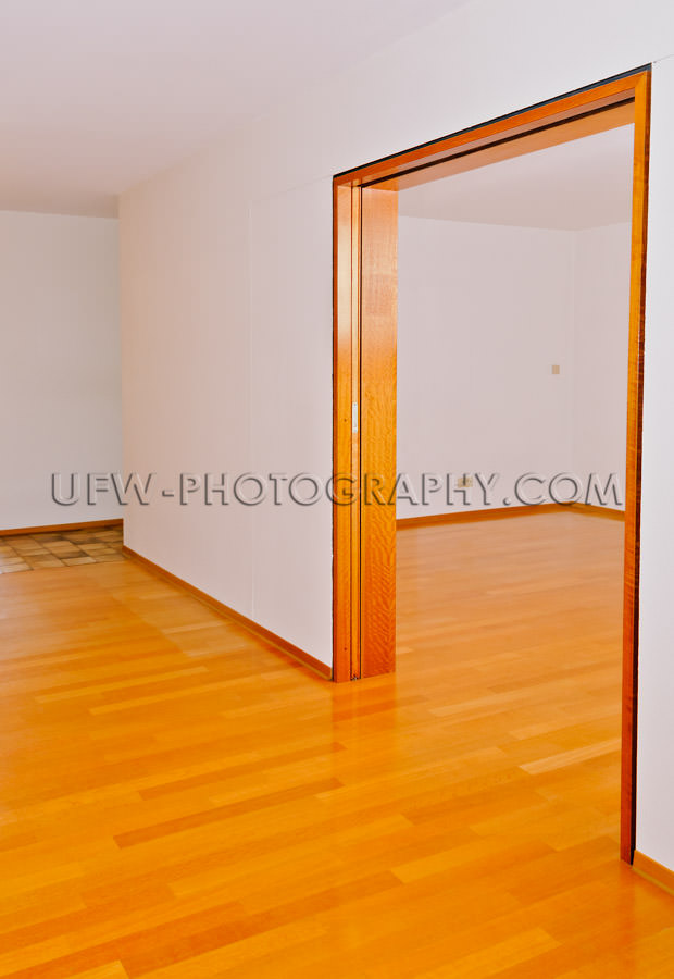 Empty apartment, dining and living rooms, wooden floor - Stock I