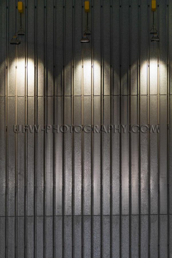 Metal wall illuminated spotlights abstract modern interior Stock
