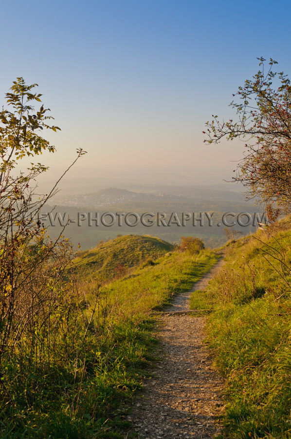 Hiking trail in the mountains, autumn scenic view, blue sky - St