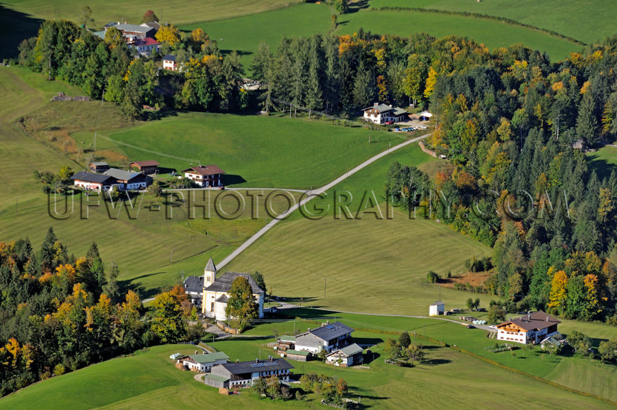 Lovely alpine countryside village dairy farms aerial view Stock