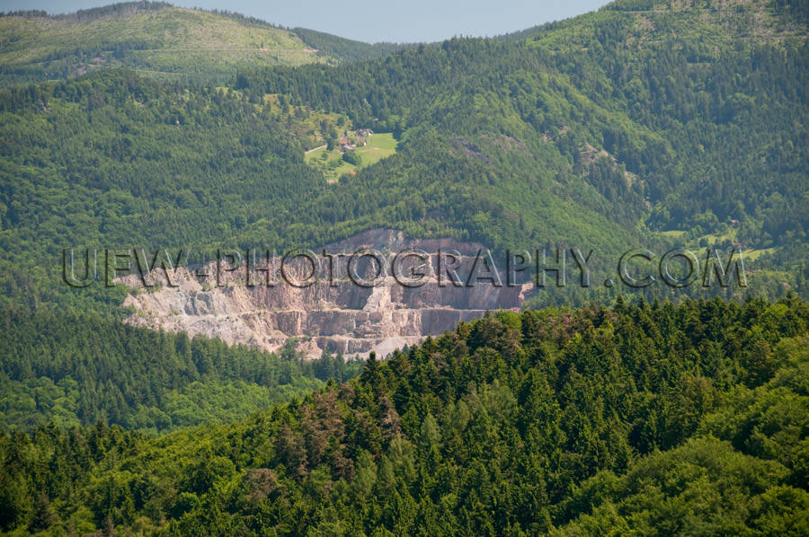 Quarry in a beautiful hilly forest landscape Stock Image