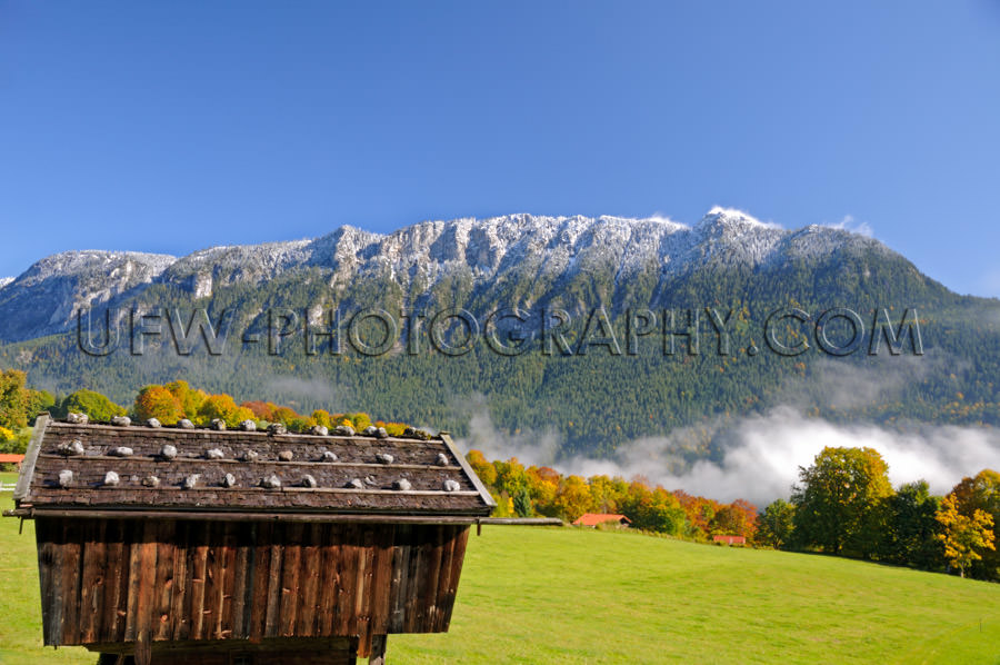 Scenic snow powdered mountain ridge, a landscape in autumn color