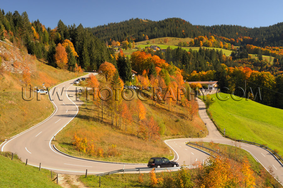 Winding mountain road colorful autumn landscape blue sky Stock I