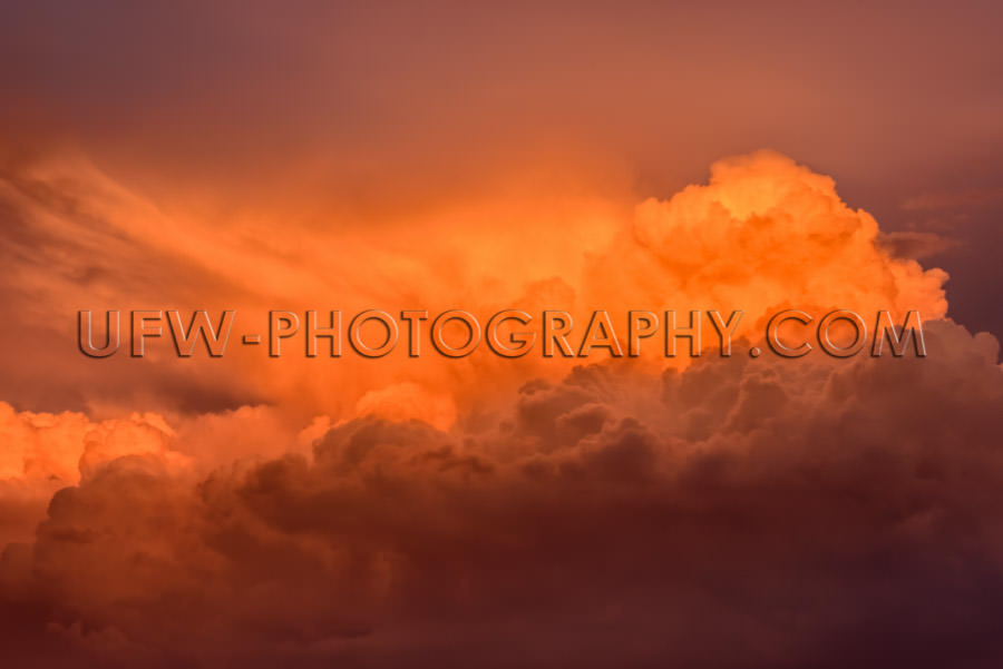 Awesome orange red dramatic cloud-scape towering dramatic sunset