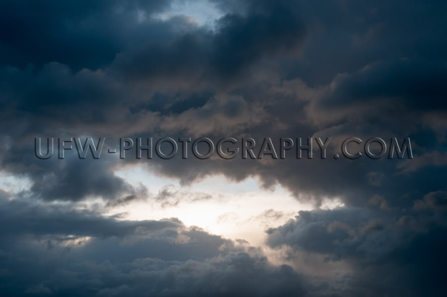 Bright patch light moody stormy cloudy sky full frame Stock Imag