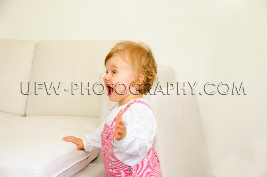 Cute little toddler girl excited fun standing shouting looking