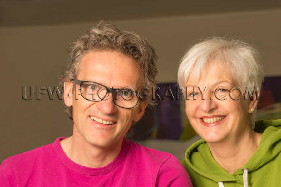 Happy smiling adult couple man woman casual looking gray hair St