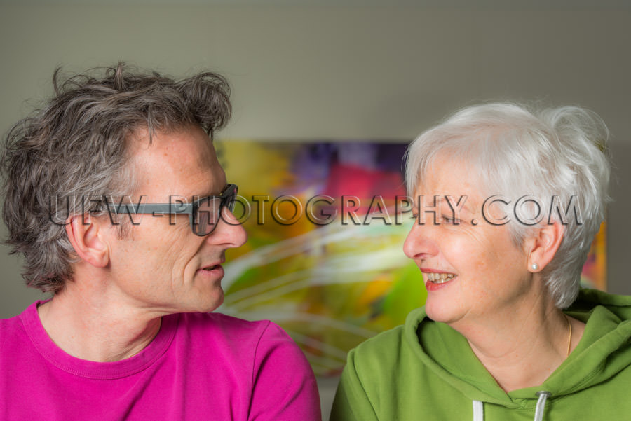 Happy smiling adult couple talking looking each other casual con