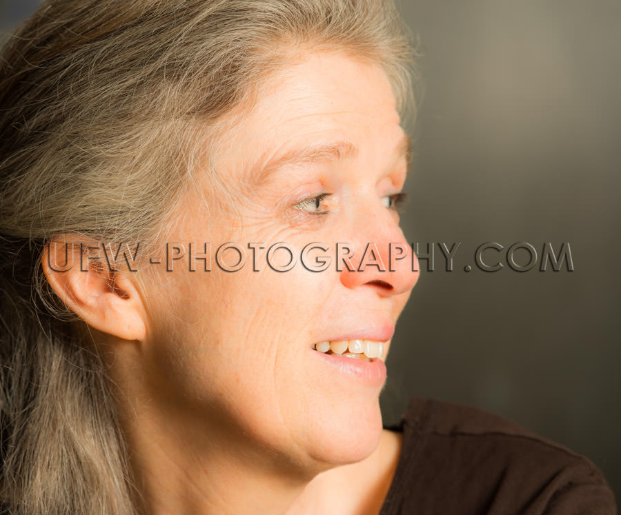 Portrait mature woman toothy smile content candid casual Stock I