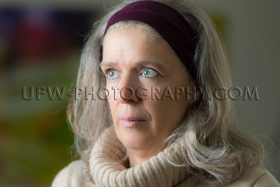 Portrait serious looking mature woman blurred background Stock I