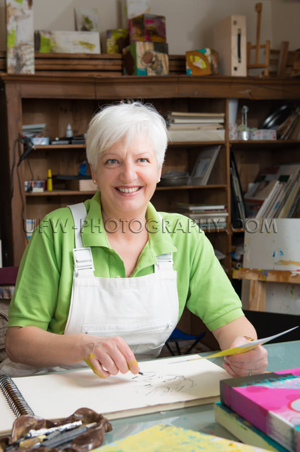 Senior woman artist working smiling drawing art studio Stock Ima