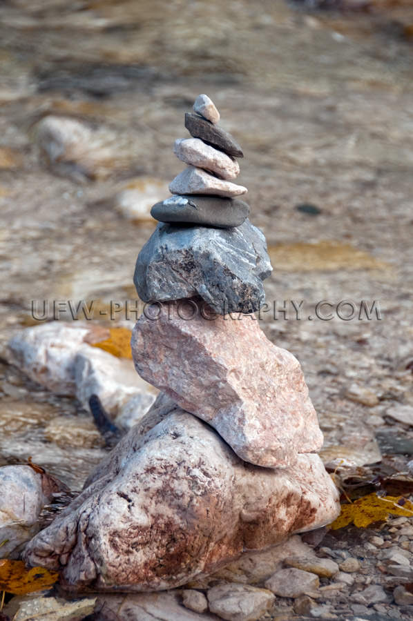 Cairn or mountain pebble stack shore mountain stream Stock Image