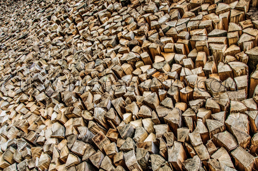 Firewood stack cut chunks endless pile full frame wood energy St