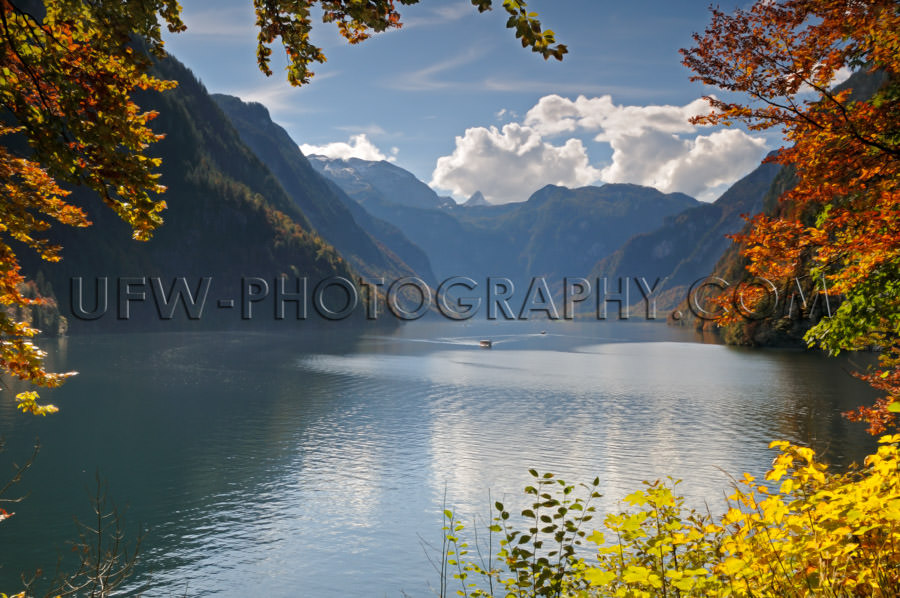 Idyllic mountain lake autumn colors framed by leaves Stock Image