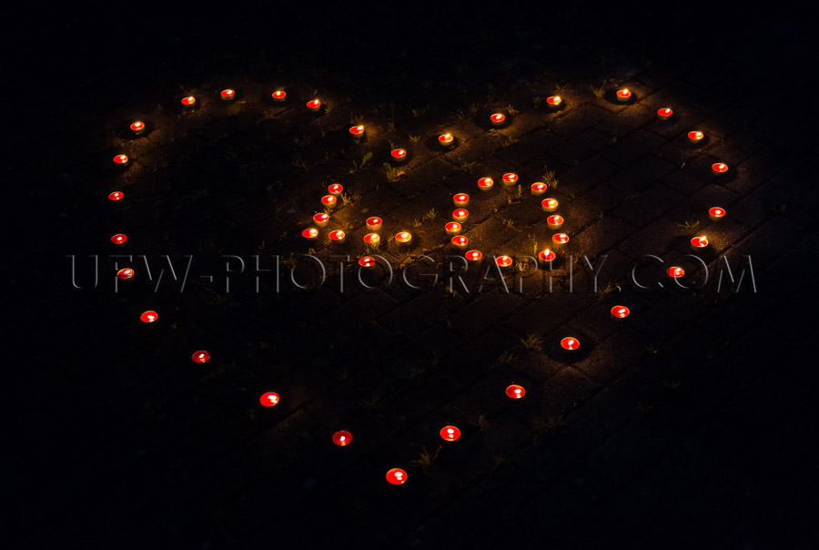 Burning tea light candles night heart-shape number 40 celebratio
