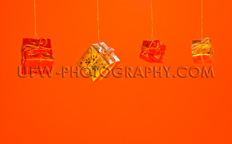 Hanging red and golden Christmas Gift Boxes Stock Image