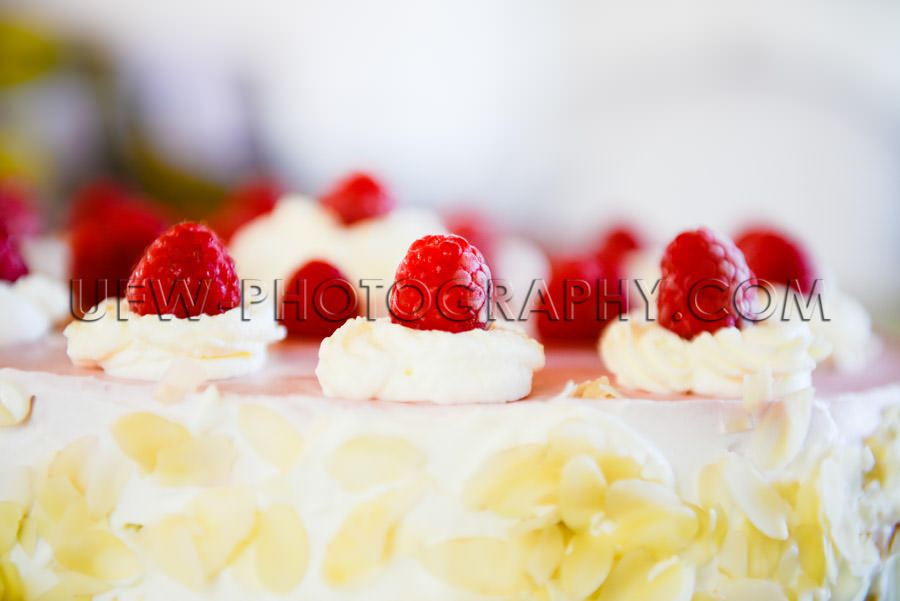 Raspberry cream cake close-up rich decorated full frame Stock Im
