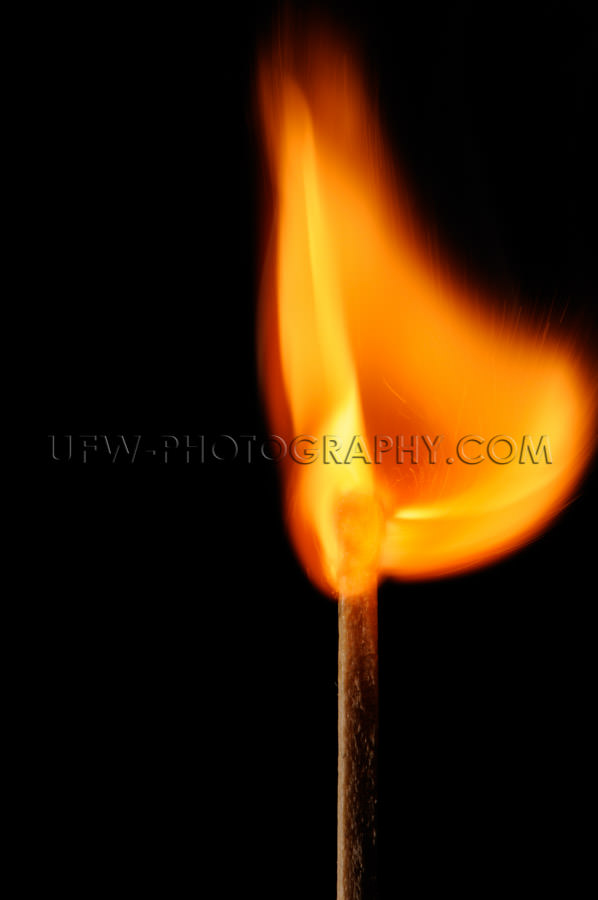 Burning matchstick creates beautifully bowl shaped flame Stock I