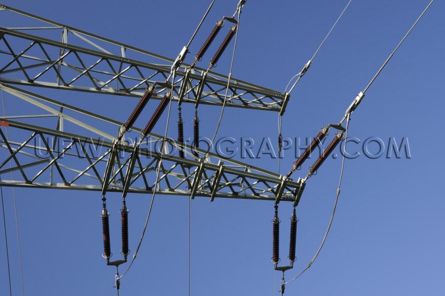 Electricity pylon arm insulator power line deep blue sky Stock I