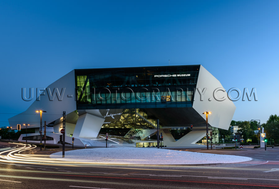 Futuristic architecture night traffic blur Porsche Museum Stock