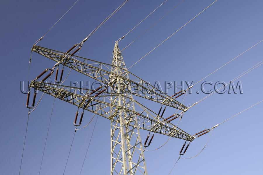 Power line and electricity Pylon, close up, deep blue sky - Stoc