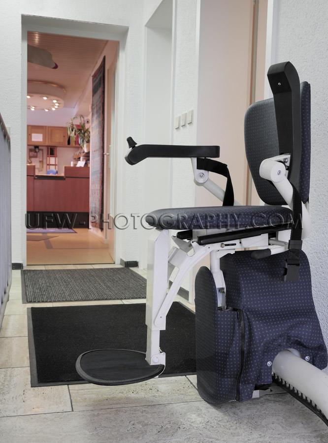 Stairlift elevator for handicapped persons chair in upstairs pos