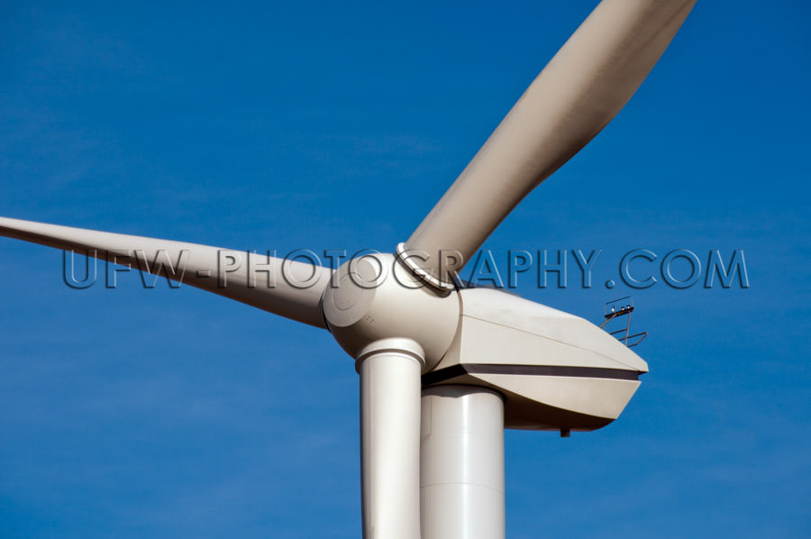 Wind-turbine close-up of blades and generator blue sky Stock Ima