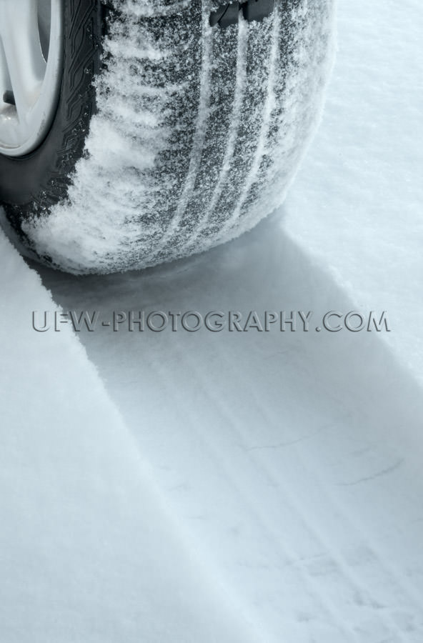 Winter tire on snow covered road Stock Image