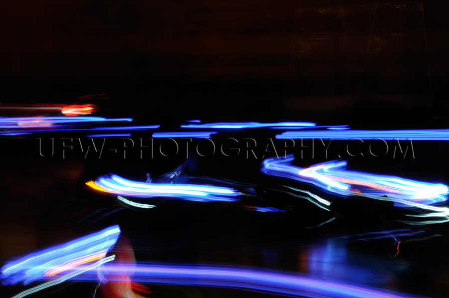 Abstract moving traffic lights red white blue motion blur Stock